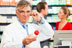 Pharmacist checking the medicine price